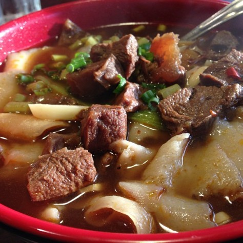 Sichuan King's Beef Noodle Soup with sliced noodles.