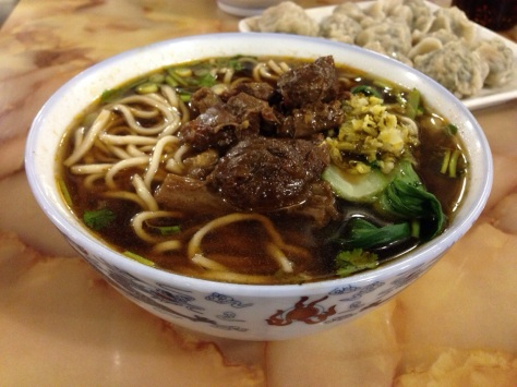 A delicious bowl of beef noodle soup.